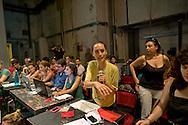 Roma 2 Agosto 2014<br /> Assemblea nazionale sul palco del teatro Valle occupato  da lavoratrici e lavoratori dello spettacolo dal 14 Giugno 2011, cui partecipano lavoratori dello spettacolo, attivisti e rappresentanti di realt&agrave; simili al teatro Valle occupato, per decidere  sullo sgombero del Teatro chiesto dal sindaco di Roma  Ignazio Marino, per riconsegnarlo alla sovrintendenza per i lavori di ristrutturazione. Ilenia Caleo, attrice, portavoce del Teatro Valle Occupato (C)<br /> <br /> Rome August 2, 2014 <br /> National Assembly on stage at the Teatro Valle occupied by workers and workers of the show from June 14, 2011, with the participation of workers in the entertainment, activists and representatives of reality similar to the occupied Teatro Valle, for decide on the eviction of the theater asked by the mayor of Rome Ignazio Marino, to return it to the superintendent for renovations. Ilenia Caleo, actress, spokesperson for the Teatro Valle Occupied (C)