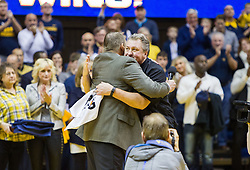 Dec 17, 2016; Morgantown, WV, USA; West Virginia Mountaineers head coach Bob Huggins and West Virginia Mountaineers athletic director Shane Lyons celebrate Huggins reaching 800 career wins at WVU Coliseum. Mandatory Credit: Ben Queen-USA TODAY Sports