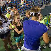 August 20, 2014, New Haven, CT:<br /> Kirsten Flipkens signs autographs for fans after defeating Andrea Petkovic on day six of the 2014 Connecticut Open at the Yale University Tennis Center in New Haven, Connecticut Tuesday, August 19, 2014.<br /> (Photo by Billie Weiss/Connecticut Open)