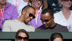 LONDON, ENGLAND - Wednesday, June 29, 2011: Formula one race driver Lewis Hamilton and half-brother Nicolas during the Gentlemen's Singles Quarter-Final match on day nine of the Wimbledon Lawn Tennis Championships at the All England Lawn Tennis and Croquet Club. (Pic by David Rawcliffe/Propaganda)