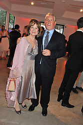 SIMON KELNER and BARONESS HELENA KENNEDY at a dinner in aid The Journalism Foundation held at Philips De Pury & Company, Howick Place, London, SW1 on 22nd May 2012.