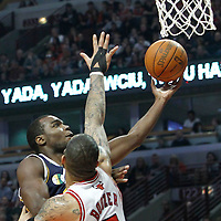10 March 2012: Utah Jazz power forward Paul Millsap (24) goes for the layup past Chicago Bulls power forward Carlos Boozer (5) during the Chicago Bulls 111-97 victory over the Utah Jazz at the United Center, Chicago, Illinois, USA.
