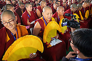 a Korean reporter with some of the twenty nuns to be awarded Geshe-ma degrees sitting in the front row in the courtyard of Drepung Lachi Monastery in Mundgod, Karnataka, India on December 22, 2016