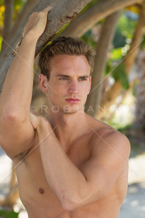 portrait of a good looking man at the beach in Florida