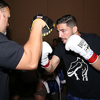 Julian Rodriguez warms up for his fight against Claudionel Lacerda during theTop Rank boxing event at Osceola Heritage Park in Kissimmee, Florida on September 22, 2016.