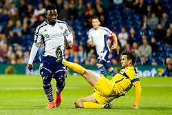 Stephane Sessegnon of West Brom is challenged by Jake Wright of Oxford United - Photo mandatory by-line: Rogan Thomson/JMP - 07966 386802 - 26/08/2014 - SPORT - FOOTBALL - The Hawthorns, West Bromwich - West Bromwich Albion v Oxford United - Capital One Cup Round 2.