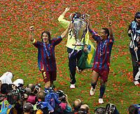 Photo: Chris Ratcliffe.<br /> Arsenal v Barcelona. UEFA Champions League Final. 17/05/2006.<br /> Ronaldinho and Carles Puyol celebrate.