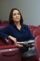 Business woman sitting in auditorium