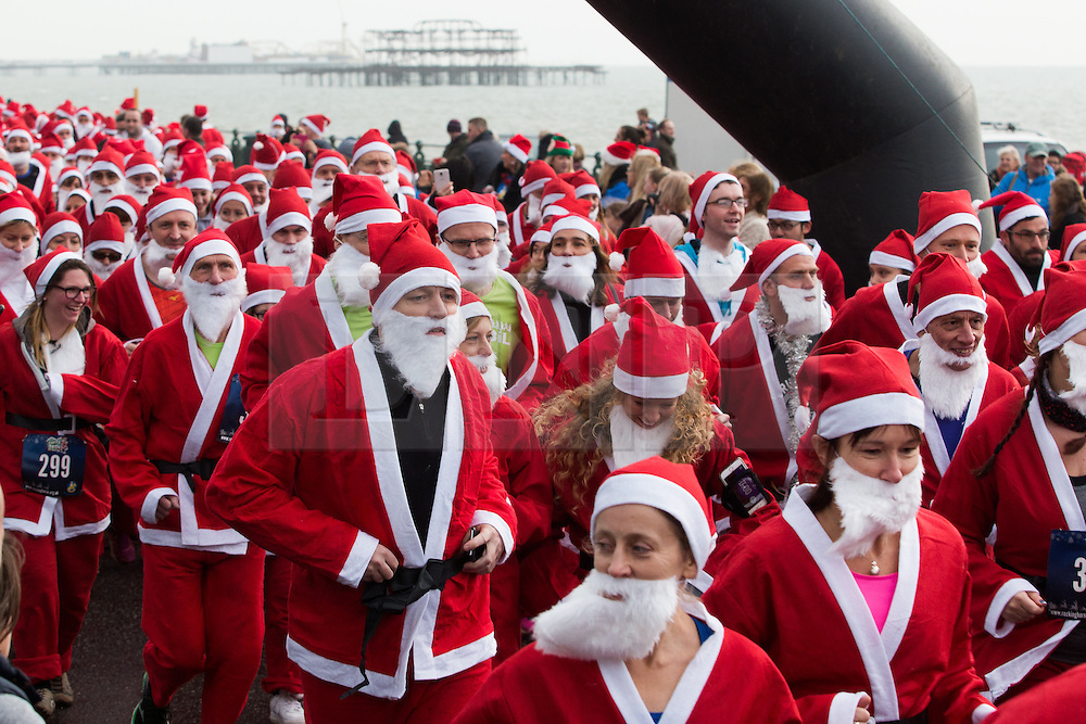 © Licensed to London News Pictures. 12/12//2015. Brighton, UK. Thousands of runners dressed as Santa Claus take part in the yearly Brighton Santa Dash in aid of Brighton's Children's Charity Rockinghorse. Today December 12th 2015. Photo credit: Hugo Michiels/LNP