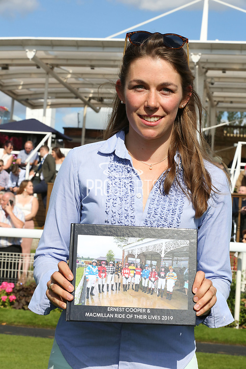 Charlotte Atkinson the 2019 Macmillan Race Winner with her momento  during the Family Race Day held at York Racecourse, York, United Kingdom on 8 September 2019.