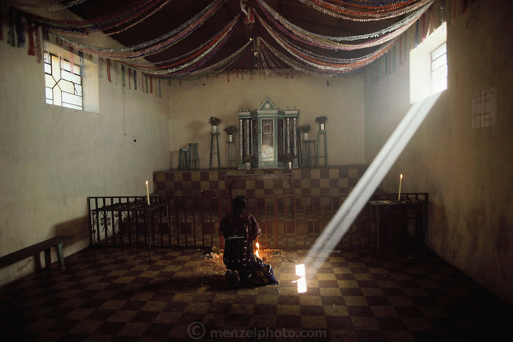 Gabriel Calixta praying in the cemetery chapel at Solola, Guatemala on Lake Atitlan.