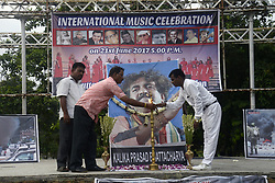 June 21, 2017 - Kolkata, West Bengal, India - Music enthusiast pays tribute to Bengali folk artist Kalika Prasad Bhattacharya who died in a car accident this year on the occasion World Music Day on June 21, 2017 in Kolkata. (Credit Image: © Saikat Paul/Pacific Press via ZUMA Wire)