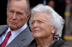 Former President George H.W. Bush and former First Lady Barbara Bush unveil the Extra Mile - Points of Light Volunteer Pathway, a mile-long pathway of bronze medallions blocks from the White House. The Extra Mile will honor up to 70 Americans 'who dedicated their lives to building service-oriented movements that have benefited American society.' in October 13, 2005 in Washington, DC. Photo by Olivier Douliery/ABACAPRESS.COM