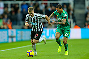 Matt Ritchie (#11) of Newcastle United drives the ball forward pursued by Jose Holebas (#25) of Watford during the Premier League match between Newcastle United and Watford at St. James's Park, Newcastle, England on 3 November 2018.