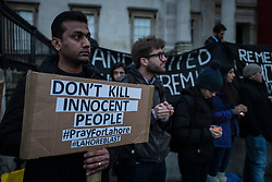© Licensed to London News Pictures. 28/03/2016. London, UK. A man stands in London's Trafalgar Square as part of a vigil for the victims of  the Easter Sunday suicide bombing in a busy public park in Lahore, Pakistan. A faction of the Pakistani Taliban, Jamaat-ul-Ahrar, has claimed responsibility for the attack which killed at least 70 people and wounding more than 300.  Photo credit : Rob Pinney/LNP