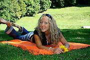 attractive blonde in strange pose in park