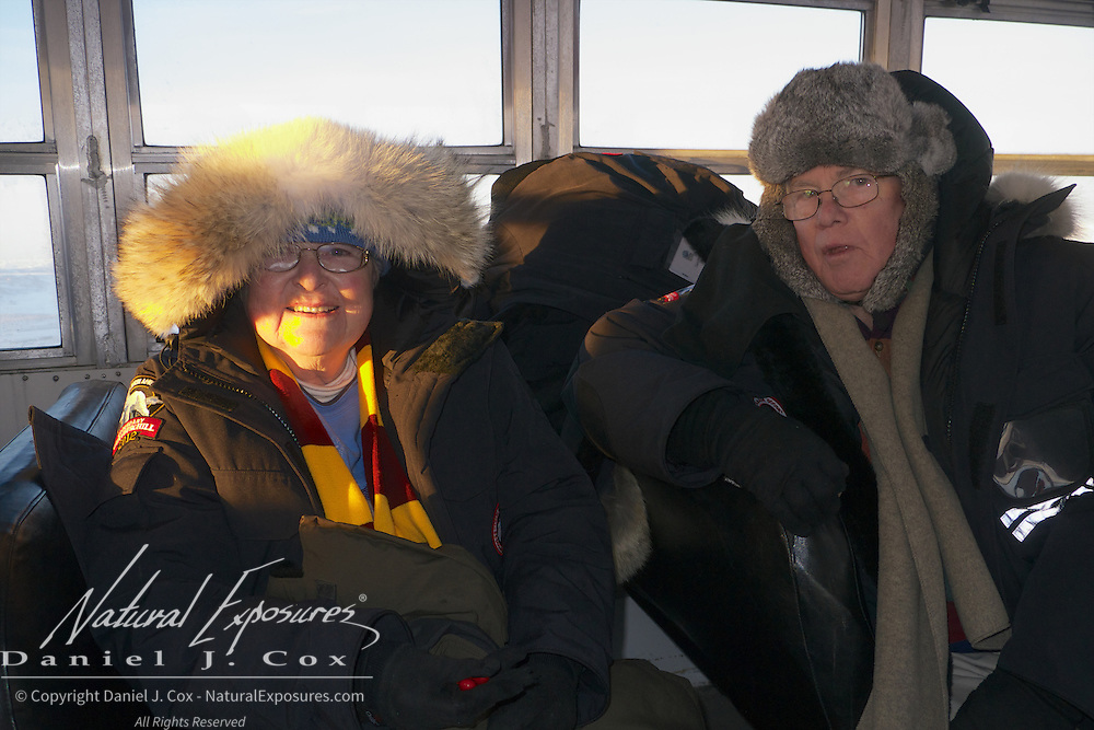 Jill and James Hewicker try to say warm on the Tundra Buggy while viewing polar bears along Hudson Bay, Cape Churchill, Manitoba.
