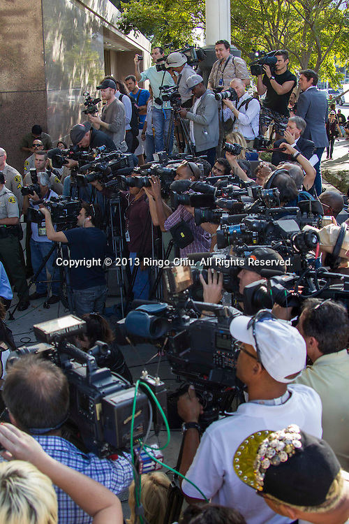 Media members crowd at outside a courthouse on Wednesday, Oct. 2, 2013, in Los Angeles. A jury cleared AEG Live of negligence in a case that attempted to link the death of Michael Jackson to the company that promoted his ill-fated comeback shows. (Photo by Ringo Chiu/PHOTOFORMULA.com)