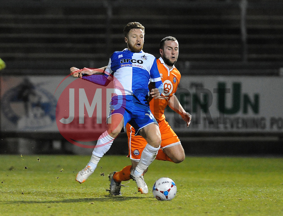 Bristol Rovers' Matty Taylor is pulled back by Braintree Town's Matt Paine - Photo mandatory by-line: Neil Brookman/JMP - Mobile: 07966 386802 - 24/02/2015 - SPORT - Football - Bristol - Memorial Stadium - Bristol Rovers v Braintree - Vanarama Football Conference