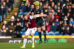 Caglar Soyuncu of Leicester City beats Chris Wood of Burnley to a header - Mandatory by-line: Robbie Stephenson/JMP - 19/01/2020 - FOOTBALL - Turf Moor - Burnley, England - Burnley v Leicester City - Premier League