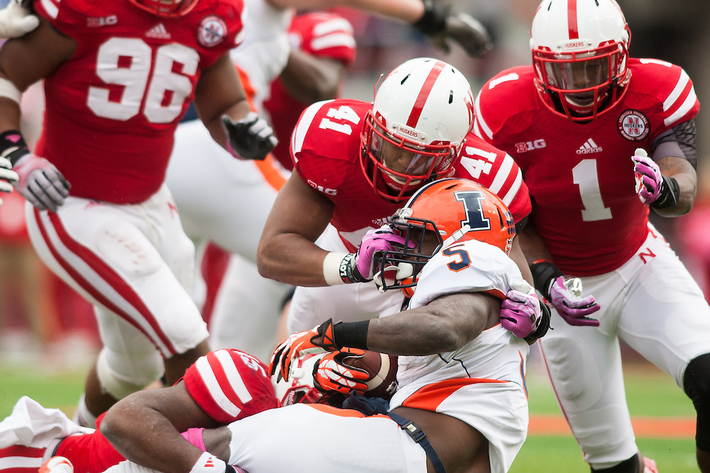 October 5, 2013: Running back Donovonn Young (5) of the Illinois Fighting Illini stopped by linebacker David Santos (41), linebacker Michael Rose (15) of the Nebraska Cornhuskers at Memorial Stadium in Lincoln, Nebraska. Nebraska defeated Illinois 39 to 19.