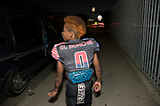 """Maxwell """"Bunchie"""" Young, 10, walks home after a scrimmage with the Hub City TarHeels U-10 he plays for. They practice at Creshaw High School, which is just blocks from his house. His dad and little sister were just behind him."""
