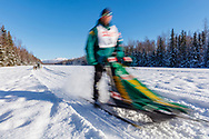 Musher Michael Tetzner competing in the Fur Rendezvous World Sled Dog Championships at Campbell Airstrip in Anchorage in Southcentral Alaska. Winter. Afternoon.