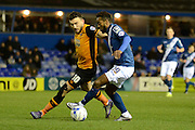 Birmingham City midfielder Jacques Maghoma takes on Hull City midfielder Robert Snodgrass during the Sky Bet Championship match between Birmingham City and Hull City at St Andrews, Birmingham, England on 3 March 2016. Photo by Alan Franklin.