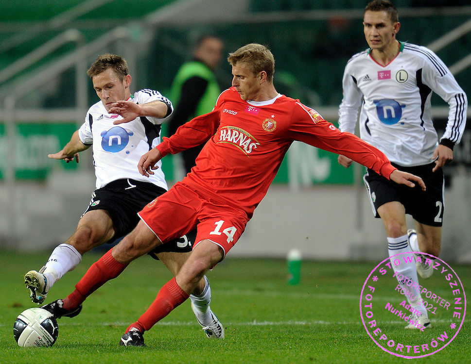 (L) Legia's Maciej Rybus fights for the ball with (R) Widzew's Krzysztof Ostrowski during T-Mobile Extraleague soccer match between Legia Warsaw and Widzew Lodz in Warsaw, Poland...Poland, Warsaw, October 23, 2011..Picture also available in RAW (NEF) or TIFF format on special request...For editorial use only. Any commercial or promotional use requires permission...Photo by Adam Nurkiewicz / Mediasport