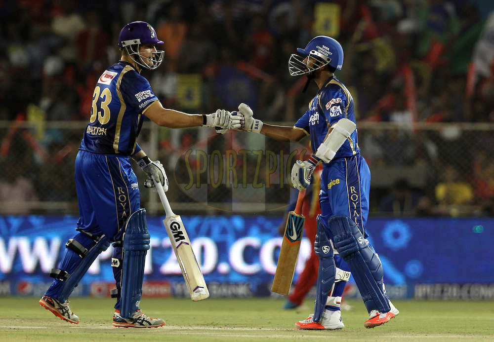 Rajasthan Royals captain Shane Watson and Rajasthan Royals player Ajinkya Rahane during match 22 of the Pepsi IPL 2015 (Indian Premier League) between The Rajasthan Royals and The Royal Challengers Bangalore held at the Sardar Patel Stadium in Ahmedabad , India on the 24th April 2015.<br /> <br /> Photo by:  Vipin Pawar / SPORTZPICS / IPL