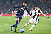 Manchester United Defender Chris Smalling takes on Juventus Midfielder Rodrigo Bentancur during the Champions League Group H match between Juventus FC and Manchester United at the Allianz Stadium, Turin, Italy on 7 November 2018.