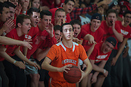 The Cherry Hill Student section screams as Cherokee's Tyler Tobin inbounds the ball during the South Jersey Group 4 boys basketball championship game played at Cherry Hill East High School in Cherry Hill Twp, NJ, Monday, March 9, 2015. Cherry Hill defeated Cherokee for the championship. Photo by Bryan Woolston / @woolstonphoto.
