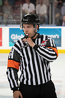 KELOWNA, BC - SEPTEMBER 21:  Referee Nick Panter blows the whistle in front of the bench at the Kelowna Rockets against the Spokane Chiefs at Prospera Place on September 21, 2019 in Kelowna, Canada. (Photo by Marissa Baecker/Shoot the Breeze)