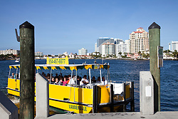 Ft. Lauderdale, FLorida:  Watertaci pulls up to a stop.  Water taxis take sightseers as well as residents to various points on the Intracoastal Canal and New River, both of which form an inside waterway that parallels Ft. Lauderdale Beach.