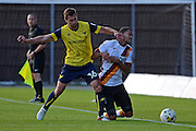 Oxford United defender Phil Edwards (16) and Bradford City midfielder Timothee Dieng (8) battle for possession 0-0 during the EFL Sky Bet League 1 match between Oxford United and Bradford City at the Kassam Stadium, Oxford, England on 15 October 2016. Photo by Alan Franklin.