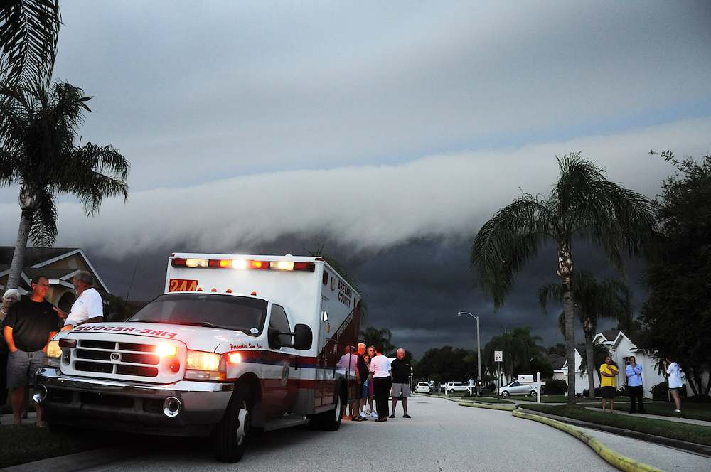 Andrew Knapp, FLORIDA TODAY -- July 27, 2011 -- A shelf cloud approaches as firefighters battle a fire Wednesday evening at a house on Carriage Hill Road in Suntree.