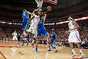 November 8, 2013: Leslee Smith (21) of the Nebraska Cornhuskers and Filip Cvjeticanin (15) of the Florida Gulf Coast Eagles going for the rebound at the Pinnacle Bank Areana, Lincoln, NE. Nebraska defeated Florida Gulf Coast 79 to 55.