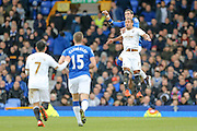 Everton defender Ramiro Funes Mori   out jumps Swansea City midfielder Wayne Routledge  during the Barclays Premier League match between Everton and Swansea City at Goodison Park, Liverpool, England on 24 January 2016. Photo by Simon Davies.