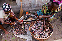 Nigeria - Fishmongers scaling and cleaning the day's catch