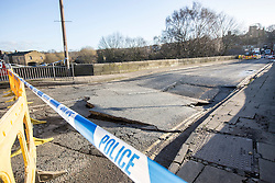 © Licensed to London News Pictures. 29/12/2015. Elland UK. Picture shows a partly collapsed bridge over the Calder & Hebble Navigation at Greenway in Elland after recent flooding.  Photo credit: Andrew McCaren/LNP