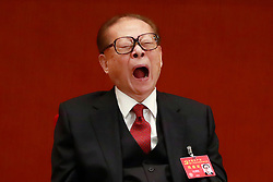 epa06272488 Former Chinese President Jiang Zemin yawns during the opening ceremony of the 19th National Congress of the Communist Party of China (CPC) at the Great Hall of the People (GHOP) in Beijing, China, 18 October 2017. China holds the 19th Congress of the Communist Party of China, the country's most important political event where the party's leadership is chosen and plans are made for the next five years. Xi Jinping is expected to remain as the General Secretary of the Communist Party of China for another five-year term.  EPA-EFE/HOW HWEE YOUNG