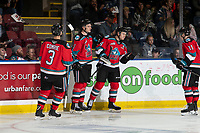 KELOWNA, BC - SEPTEMBER 28: Sean Comrie #3, Jake Lee #21, Kyle Topping #24 and Pavel Novak #11 of the Kelowna Rockets celebrate a goal against the Everett Silvertips  at Prospera Place on September 28, 2019 in Kelowna, Canada. (Photo by Marissa Baecker/Shoot the Breeze)