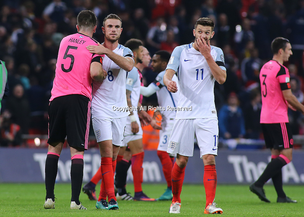 11.11.2016. Wembley Stadium, London, England. World Cup Qualifying Football. England versus Scotland. Jordan Henderson of England embraces Grant Hanley of Scotland at full time
