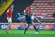 Hull City forward Jarrod Bowen (20) and Barnsley defender Aapo Halme (24) in action during the EFL Sky Bet Championship match between Barnsley and Hull City at Oakwell, Barnsley, England on 30 November 2019.