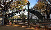 Passerelle Bichat, a cast iron arched pedestrian footbridge built late 19th century in the Recollets basin, between the Quai de Valmy and Quai de Jemmapes, over the Canal Saint-Martin in the 10th arrondissement of Paris, France. The Canal Saint-Martin is a 4.6km long waterway between the Canal de l'Ourcq and river Seine, built 1802-25 to provide a fresh water source to the city and provide a trade route for canal barges. Picture by Manuel Cohen