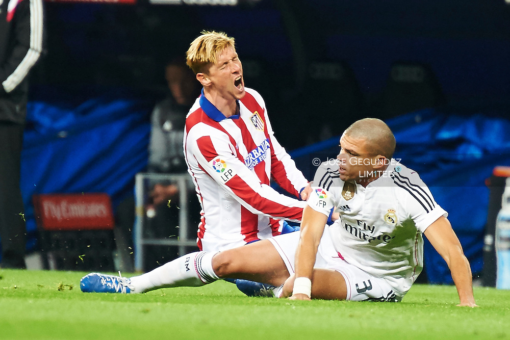 Fernando Torres and Pepe during the Copa del Rey, round of 8 match between Real Madrid and Atletico de Madrid at Estadio Santiago Bernabeu on January 15, 2015 in Madrid, Spain.