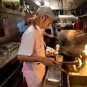 Chef Danny Bowien works in the kitchen of his restaurant, Mission Chinese, at its New York City location on the Lower East Side of Manhattan on Tuesday, July 31, 2012 in New York, NY...