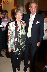 MISS LIBBY REEVES PURDY and MR JOHN CHALK  at the 2005 Clicquot Award - Business Woman of The Year award ceremony held at Claridge's, Brook Street, London W1 on 28th April 2005.
