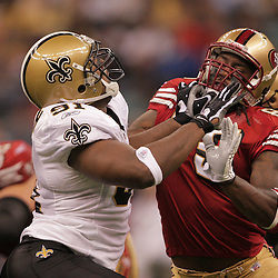 2008 September 28: San Francisco 49ers tight end Vernon Davis (85) blocks New Orleans Saints defensive end Will Smith (91) during the NFL week four game between the San Francisco 49ers and the New Orleans Saints at the Louisiana Superdome in New Orleans, LA.