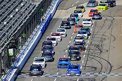 March 23, 2019 - Martinsville, VA, U.S. - MARTINSVILLE, VA - MARCH 23:   Two wide on a restart during the 21st running of the NASCAR Gander Outdoors Truck Series TruNorth Global 250 race on March 23, 2019 at the Martinsville Speedway in Martinsville, VA.  (Photo by David John Griffin/Icon Sportswire) (Credit Image: © David J. Griffin/Icon SMI via ZUMA Press)